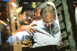 Letters rogatory: Satyam founder B. Ramalinga Raju (right) being taken into custody in Hyderabad on 18 January 2009. CBI has sought help from various countries in tracing the diversion of funds from t