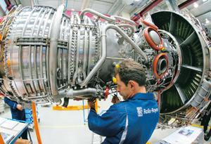 Seeking alliance: A file photo of an aircraft engine being assembled at Rolls-Royce's factory in Germany. HAL is also in talks for a joint venture with Rolls-Royce's US unit that makes military aircra