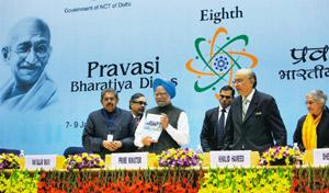 Revived hopes: PM Manmohan Singh (2nd from left) releases an investment tool kit for Indian diaspora as chief guest Lord Khalid Hameed of Hampstead looks on, during the inaugural session of Pravasi Bh