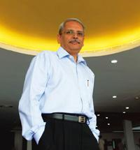 More confident: Gopalakrishnan says the indication right now is that even though the budgets could be flat, offshore spending will increase. Infosys Technologies is continuing to hire more people, he