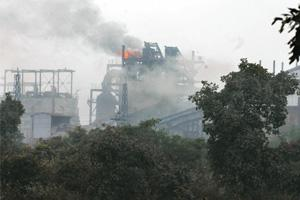 Low vigil: A sponge iron unit at Jamuria spews smoke. According to a worker at the local sponge iron unit, compliance with anti-pollution norms is the least at night, when there is no surveillance. In
