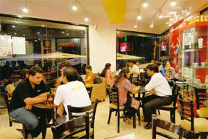 Attracting interest: A Cafe Coffee Day outlet. Hemant Mishra / Mint
