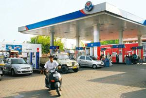 Large tab: An HPCL outlet in Faridabad, Haryana. Refining firms are estimated to lose about Rs45,000 crore selling fuel below cost. Rajkumar / Mint