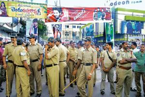Security show: Police personnel outside Odeon theatre in Hyderabad that is screening Adhurs, a movie starring Jr NTR, son of senior TDP leader N. Harikrishna, who is opposed to the creation of Telang