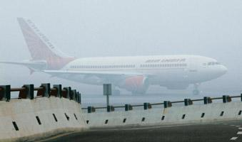 Fogged out: An Air India plane at the IGI Airport in New Delhi on 14 January; 35 flights had to be rescheduled due to dense fog. DGCA has now made the 150m visibility norm mandatory for all airlines.