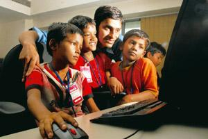 All in a day's work: Arindam Bhattacharyya of the IBM Corporate Service Corps teaches computer skills to children from poor families every Saturday. Indranil Bhoumik / Mint
