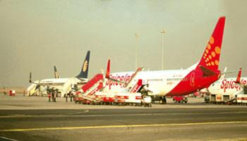 Cautious optimism: A file photo of aircraft of various domestic airlines at the Indira Gandhi International  Airport, New Delhi. SpiceJet posted a record profit of Rs108.9 crore for the quarter ended