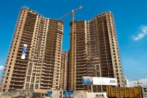 Realty hit: A file photo of DLF's Belaire project, Gurgaon. Revenue is down 20% as realization in Gurgaon projects is less than that in Delhi. Rajkumar / Mint