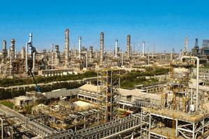 Crude production: The old RIL refinery in Jamnagar. At the current rate, the new refinery can refine 667,000 barrels a day, overtaking RIL's older Jamnagar refinery, which can process 660,000 barrels.
