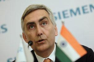 Siemens CEO Peter Loescher addresses a press briefing in New Delhi on Tuesday. Gurinder Osan / AP