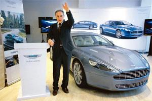 Driving in: Aston Martin CEO Ulrich Bez with the auto maker's first four-door sports car Rapide at its launch in Beijing on 24 January. Jason Lee / Reuters