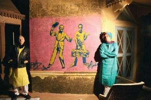 Revved up: Luhrmann (left) and Fantauzzo take a break after painting a mural in Rajasthan. Courtesy Royal Enfield