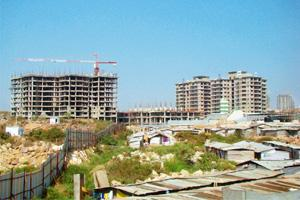 Skeletal buildings: One of the many incomplete realty projects in Hyderabad's Gachibowli area. Bangalore is gaining from Hyderabad's loss. Many real estate investors consider the Karnataka capital a s