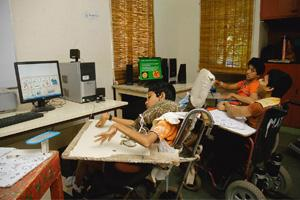 Technological aid: Children at a centre run by Vidya Sagar in Chennai operating the device. A child can activate a choice on his computer with a slight movement of the head, hands, knees or legs near