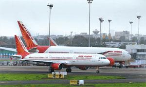 In the wings: Air India planes at the Mumbai airport. The carrier may turn its MRO and cargo operations into separate units. Abhijit Bhatlekar/Mint