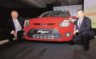 Going small: Ford India's Boneham (left) and Ford Motor's Hinrichs at the Figo's launch in New Delhi. Priyanka Parashar / Mint