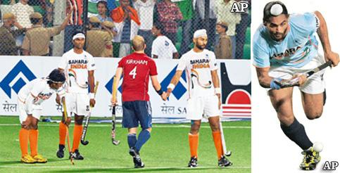 Game over: A dejected Indian team after losing to England; and (right) India's Sarwanjit Singh.