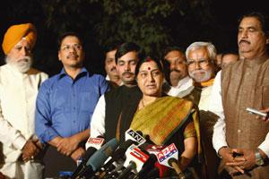 BJP whip: Senior Bharatiya Janata Party leader Sushma Swaraj with party MPs after a meeting over the women's Bill at the residence of parliamentary party chairman L.K. Advani in New Delhi on Thursday.