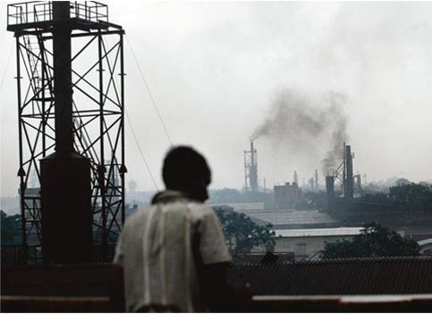 Smoke alarm: Unchecked emissions from factories undermine India's emergence as a global power. Deshakalyan Chowdhury / AFP