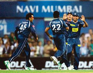 Cashing in: Deccan Chargers' players celebrate the wicket of Sourav Ganguly during the first match of IPL 3 in Navi Mumbai on Friday.  PTI