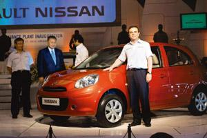 New standards: Carlos Ghosn stands next to a Nissan Micra in Chennai on Wednesday. Ghosn said the new facility in Chennai commissioned on Wednesday will serve as a benchmark for other company plants.
