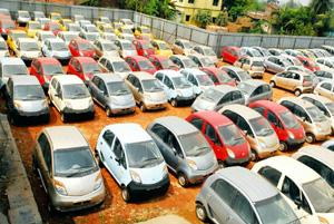 Holding area: Nano cars at the stockyard of Lexus Motors in Singur, West Bengal, barely 3km from Tata Motors' abandoned factory site. Indranil Bhoumik / Mint