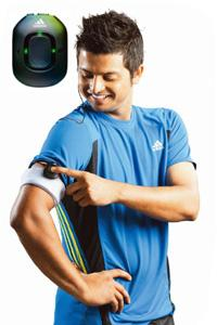 Fitness button: Cricketer Suresh Raina tries out the new Adidas miCoach.