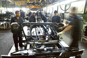 Improvement step: A Tata Motors plant in Pune. The offer covers 11.8 billion yen of zero-coupon notes and $300 million of 1% bonds. Santosh Verma / Bloomberg