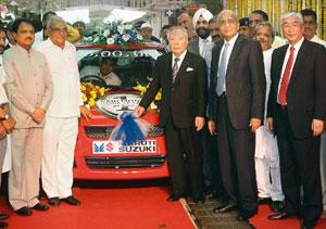 Milestone: Heavy industries minister Vilasrao Deshmukh, Haryana chief minister Bhupinder Singh Hooda, Osamu Suzuki and Maruti Suzuki chairman R.C. Bhargava during the roll-out of the millionth car. M