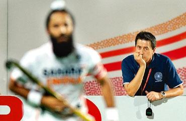 Outsourced: Spaniard Jose Brasa (right) does the thinking for India's hockey team. Manan Vatsyayana / AFP