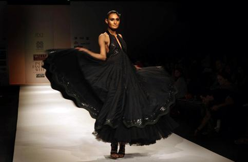An Indian model presents a creation by designers Ashish Viral and Vikrant at the Wills Lifestyle India FashionWeek Autumn Winter 2010 in New Delhi. Manish Swarup / AP