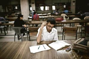 Big potential: A file photo of students from the Indian Institute of Technology, Delhi, studying in the library of the IIT campus in New Delhi. With at least 490 universities and 20,769 colleges, Indi