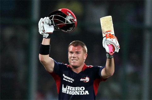 Delhi Daredevils' player David Warner celebrates his century against Kolkata Knight Riders during their IPL3 match in New Delhi on Monday. Aman Sharma/PTI