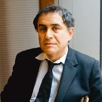 Positive signs: Nouriel Roubini. Gino Domenico / Bloomberg