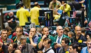 Renewed strength: Traders in the crude oil options pit at the New York Mercantile Exchange. The rise in oil prices came despite a stronger dollar, which often dampens enthusiasm for commodities. Danie
