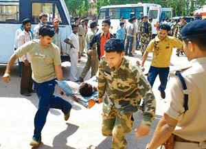 State's failure: An injured soldier being carried away after the Maoist attack. The personnel, part of a joint force of a CRPF and police team, were attacked when returning from a four-day anti-Naxal