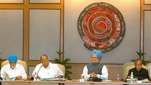Stern steps: Prime Minister Manmohan Singh chairing the meeting. PTI
