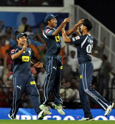 DeccanChargers' Harmeet Singh celebrates with teammates the wicket of Royal Challenger Bangalore's during their IPL T20 match in Nagpur on Monday. PTI