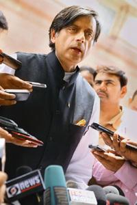 Under pressure: Shashi Tharoor speaks to the media on Friday. Atul Yadav / PTI