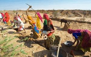 Alternative action: Villagers in Rajasthan working under the programme. The report suggests increasing budget allocation or reducing the number of days for which employment is provided under the schem