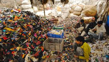 Environmental hazard: Workers segregate e-waste at a yard in Mundka. Over 90% of India's e-waste is handled by the informal sector. Ramesh Pathania/Mint