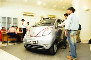 Supply eases: A Nano on display in a New Delhi showroom. Though bookings are closed officially, a new car is not that difficult to get. Ramesh Pathania / Mint