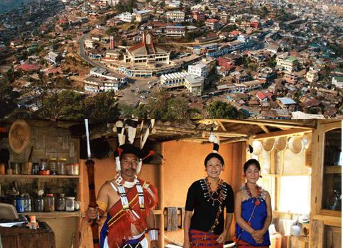 Hill town:(top) Mokokchung town; and an Ao Naga family in traditional. Photographs by Anita Tao Kashi