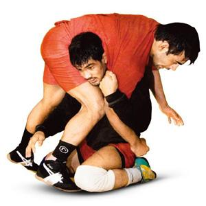 Heavy load: India's Olympic bronze medallist Sushil Kumar (in black) at a practice session.