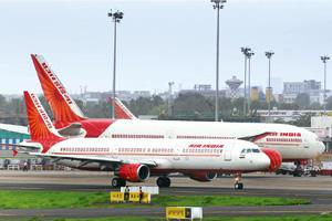 Game plan: A file photo of Air India aircraft at Mumbai International Airport. Air India, the official airline partner of the Commonwealth Games, will ferry athletes, officials and tourists.