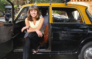 On the move: Miller, who has been with Condé Nast Traveller for 13 years, in a Mumbai taxi. Abhijit Bhatlekar/Mint