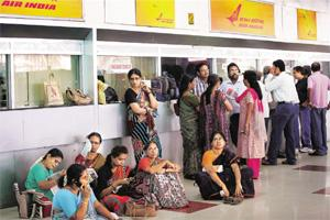 High and dry: Technical and ground staff of Air India struck work for a second day on Wednesday, leaving several passengers stranded. R Senthil Kumar / PTI