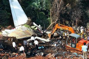 Air disaster: Rescue workers clearing the debris of the Air India plane that crashed in Mangalore on 22 May, killing 158 people. Shailendra Bhojak / PTI