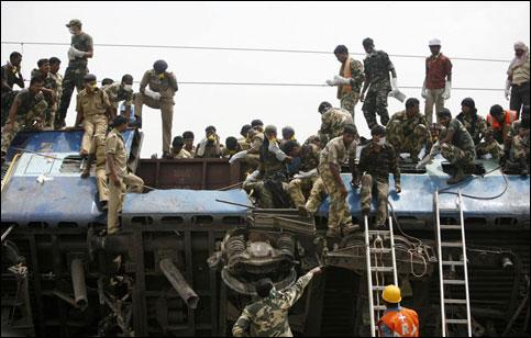 Indian Army jawans conduct rescue operations at the site of a train accident at Jhargram area in West Bengal on Friday. Parth Sanyal / Reuters