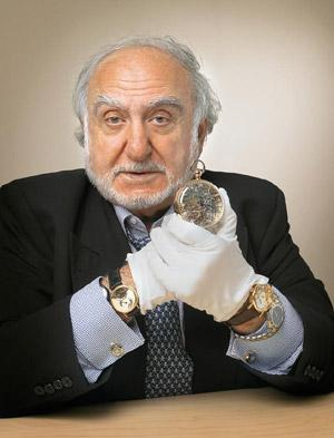 Timeless: Hayek holds in his hands the Queen Marie-Antoinette watch originally completed by Breguet in 1827. Swatch